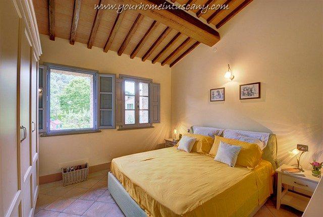 bedroom with 2 windows